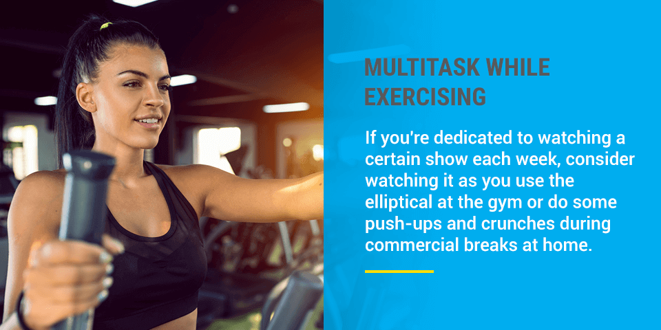 A woman multitasks her exercising at the gym